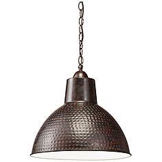 Large hand hammered metal pendant lights illuminate a barn style kichler missoula 13 12 wide bronze pendant mozeypictures Images