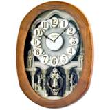 "Joyful Encore Walnut 22"" High Motion Wall Clock"